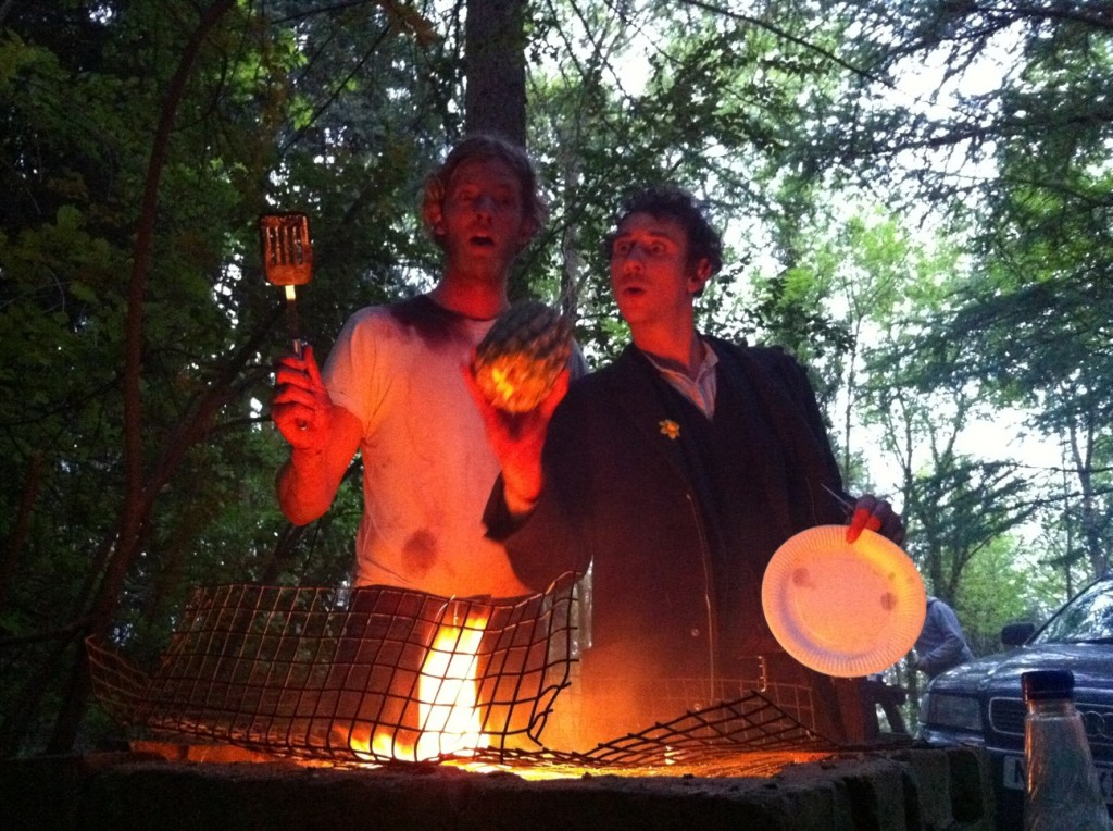 Actors, relaxing by cooking in a manly fashion.